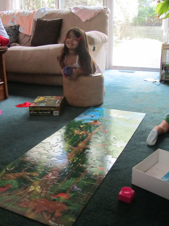 Yaya shows off her assembled new Rainforest puzzle (Thank you Lil!)