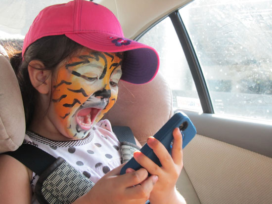 Tiger roaring and taking pictures of herself