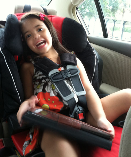 Happy girl in her new booster seat!