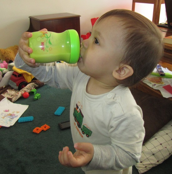 Feeding himself Pediasure in a sippy cup