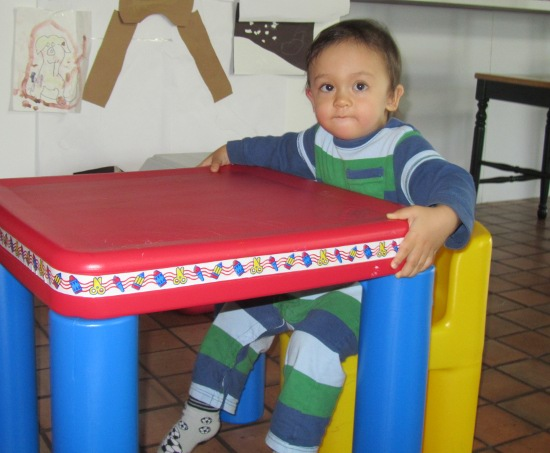 Moving the table into position (doesn't he look like Hisham here?)