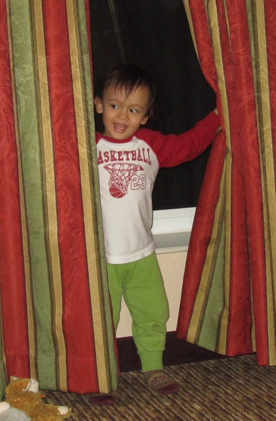 Surprise!!! Baby behind the curtain!