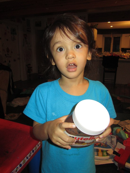 Adik loves the Nutella jar!