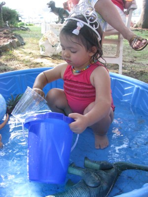 Buckets, dinosaurs and tiara-ed baby in the water