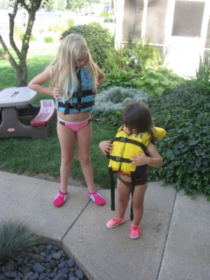 Gabby and Yaya are ready in their lifejackets