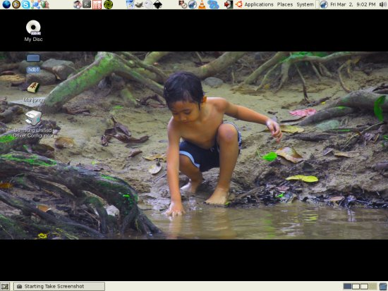 Irfan at the desktop playing with mud