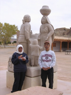 Mak and Abah by a statue