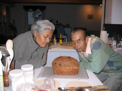 Abah and Mak smelling bread fresh from the oven